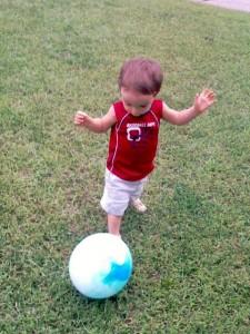 Kaden kicking his first ball