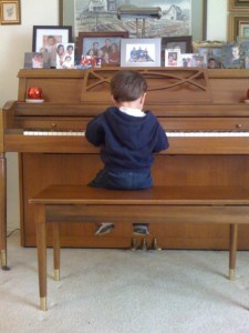 Kaden playing the piano